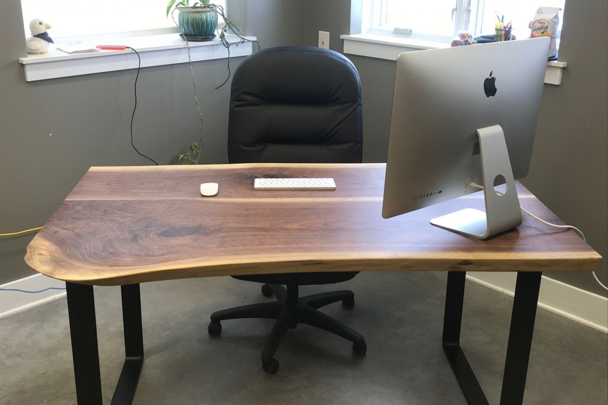live edge wood desk with computer and chair